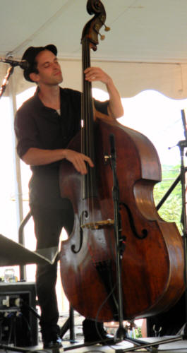 The Bass Player His Eyes Closed Playing With Feeling